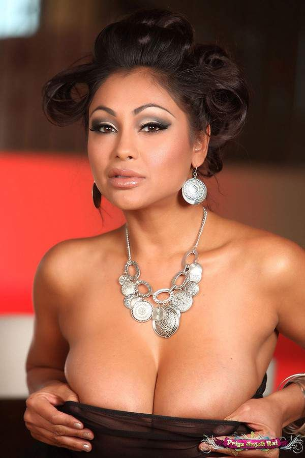 The hot and sexy famous indian pornstar priya anjali rai very erotic and seducing pics in which she is showing their milki navel boobs  clea...