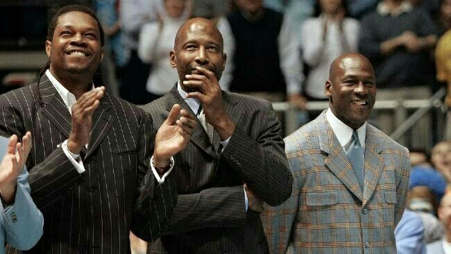 Tarheel legends Sam Perkins, James Worthy, and Michael Jordan in Chapel Hill, North Carolina to honor Dean Smith.