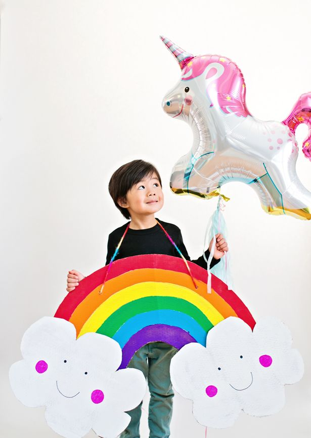 DIY Happy Rainbow Cardboard Costume for Kids. Make this easy Halloween costume for kids in no time!