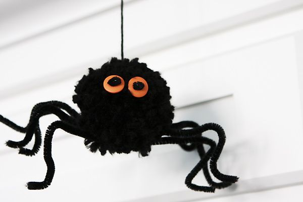 How to Make Fluffy Spiders - there are good instructions and photos of the steps.