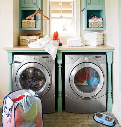 By adding a countertop and cabinets, this small nook becomes a fully-functioning laundry room. Even though the space is designed for utility...