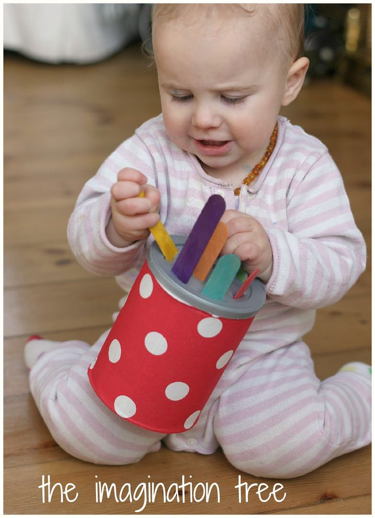 baby playing with homemade toy