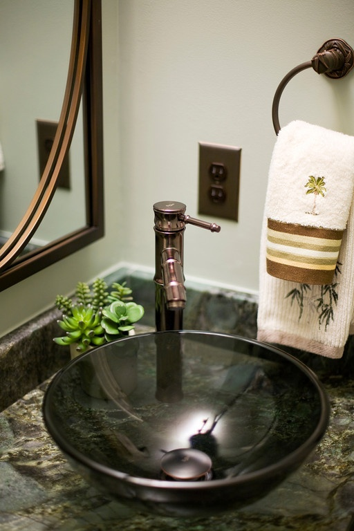 Powder Room - Gorgeous bronze bamboo faucet with matching mirror and towel ring.