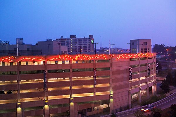 This installation is composed of neon lights mounted on metal on the exterior of the Rhode Island Convention Center parking garage. �Rhode Island Lights will bring spectacular color and energized design to [the parking garage].