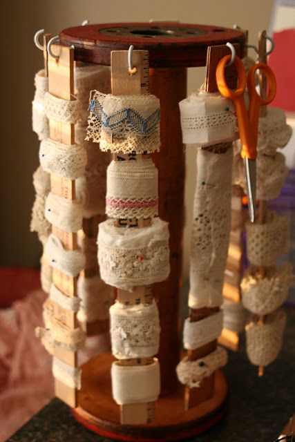 I like the fact that this spins, making it easier to see what you have. Ribbon and trim storage using old wood bobbins and paint stirrers
