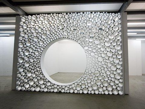 This can be done with varying sizes of PVC pipes and spray paint for any desired affect. Could do a small section of a wall next to the art area and use as storage for markers, crayons, pens, etc.
