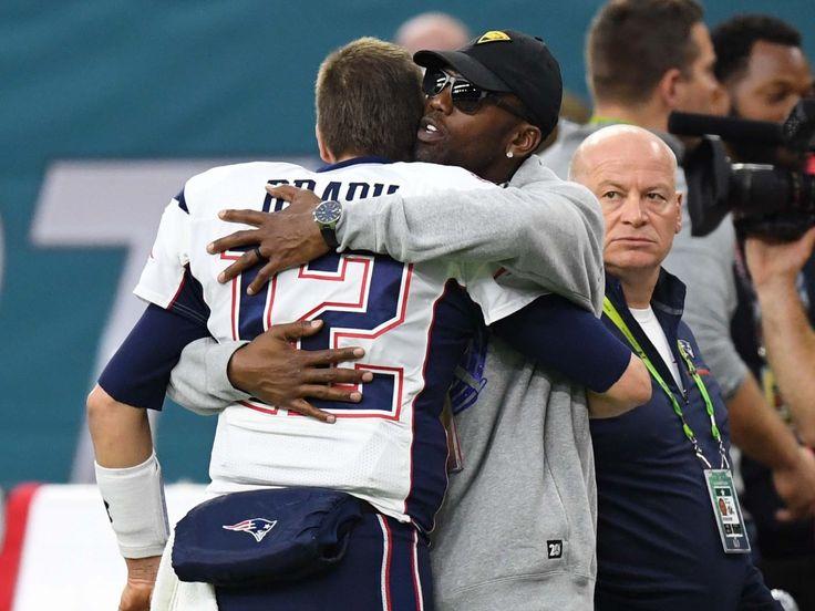 Patriots quarterback Tom Brady gets a hug from former