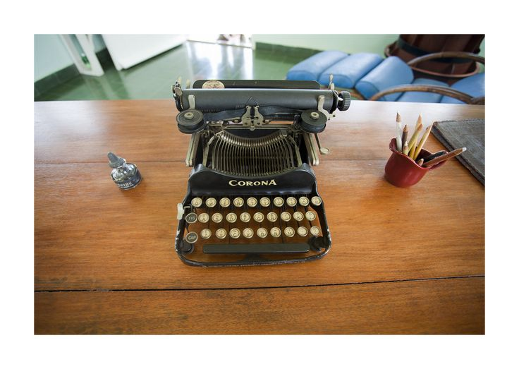 """Hemingway's typewriter in his Cuban home, Finca Vigía (Lookout farm). The villa has remained as it was the day he left it for the last time (he returned to the US to be treated for severe depression, before his suicide a year later).  It was here, on his Corona, that he wrote much of """"For Whom The Bell Tolls"""" (started at the Hotel Ambos Mundos). """"The Old Man And The Sea"""" was also written here.  en.wikipedia.org/wiki/Finca_Vig%C3%ADa"""
