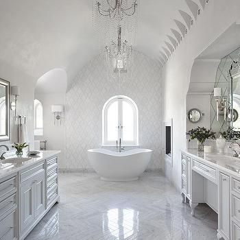 White Master Bathroom with Barrel Ceiling and Marble Chevron Floor