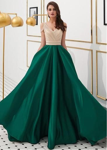 88113b2f41 Live your fairytale fantasy with this prom dress. It is made of satin.  Exquisite beadings adorn the bodice