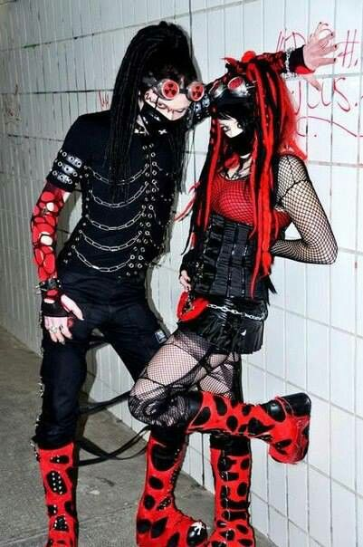 Cyber goth (couple): a subculture that derives from elements of cyberpunk, goth, raver, and rivethead fashion. Unlike traditional goths, Cybergoths follow electronic dance music more often than rock.