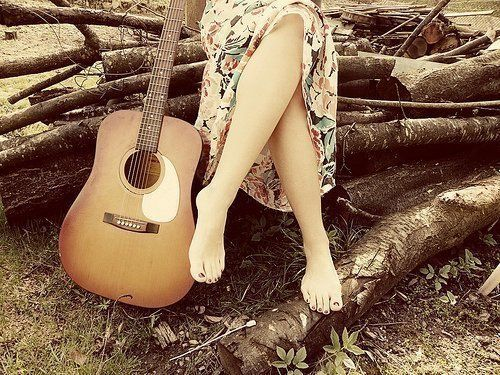 this is cute =) i wanna sit on a log (or in this case a pile of sticks) and play my guitar
