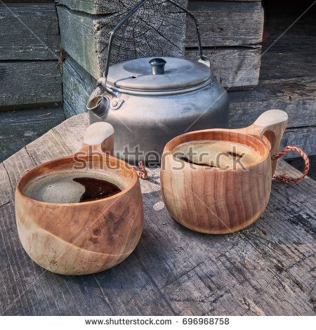 Stock Photo: Two wooden mugs filled with hot fresh coffee on the campsite while trekking. -