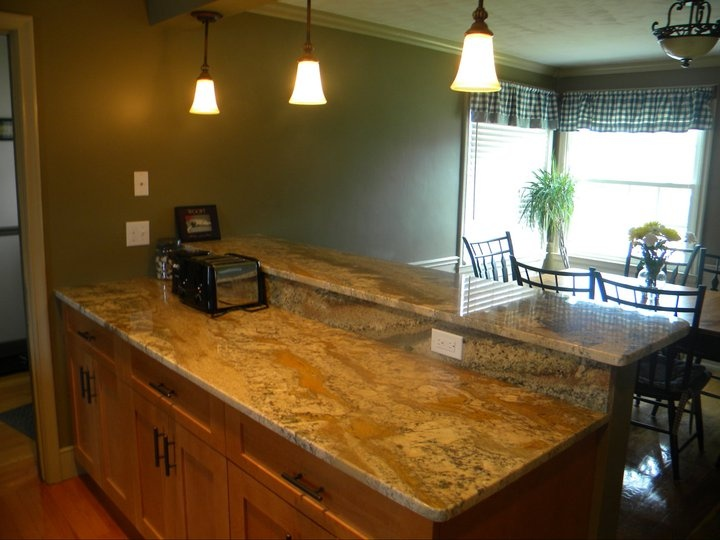 Neptune Bordeaux Granite Kitchen With Beautiful Lighting