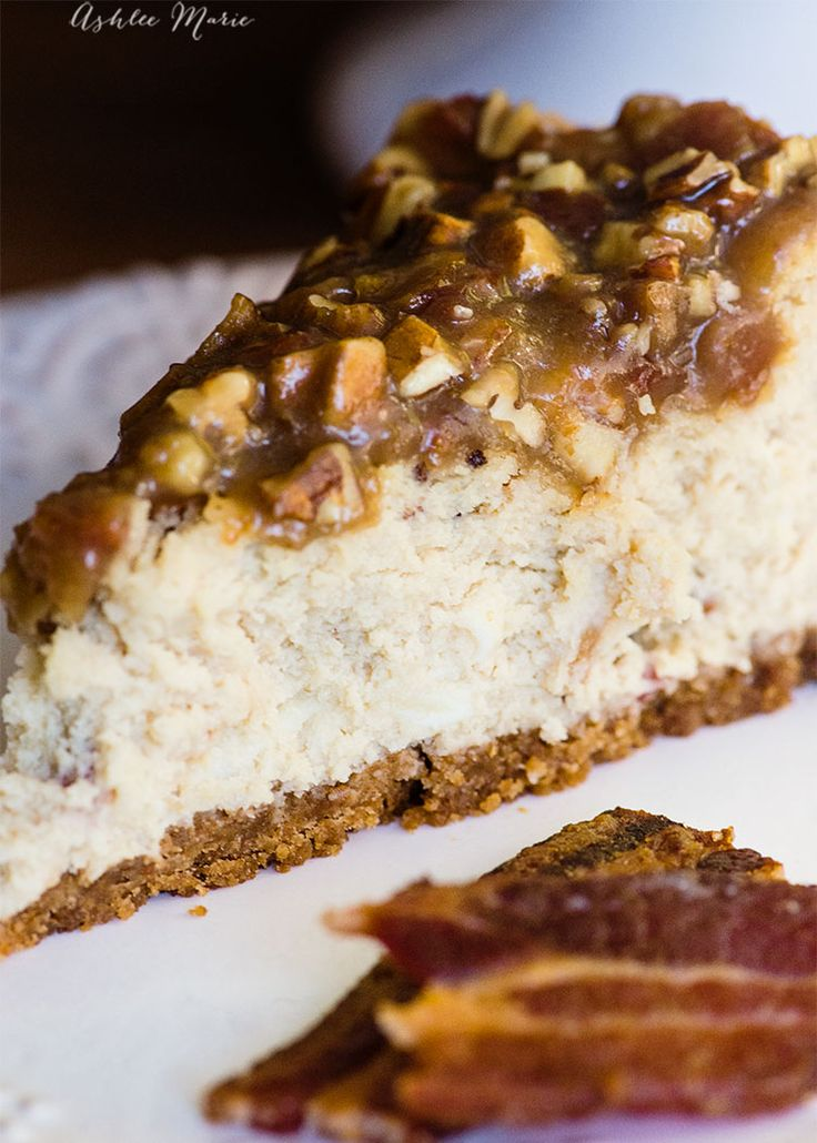 A creamy maple cheesecake with chunks of candied bacon and topped with a bacon pecan caramel dessert topping