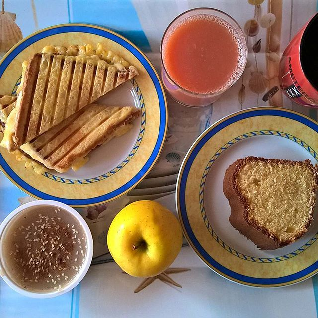 A breakfast spread is always better: A grilled cheese with salami, Emmental, smoked cheese, mozzarella and an Emmental cheese crust, a piece of her latest ultra fluffy cake, a moustalevria and an apple. #thenewbreakfasteverydayproject #livingmylifemyway