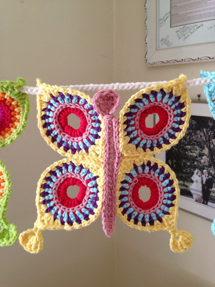 "Add this beautiful crocheted butterfly bunting to your home! Perfect for a little girls room. Great baby shower gift. Fun backdrop for professional photographers photo shoot. This bunting includes seven 8"" butterflies on 58"" strand. 100% cotton."