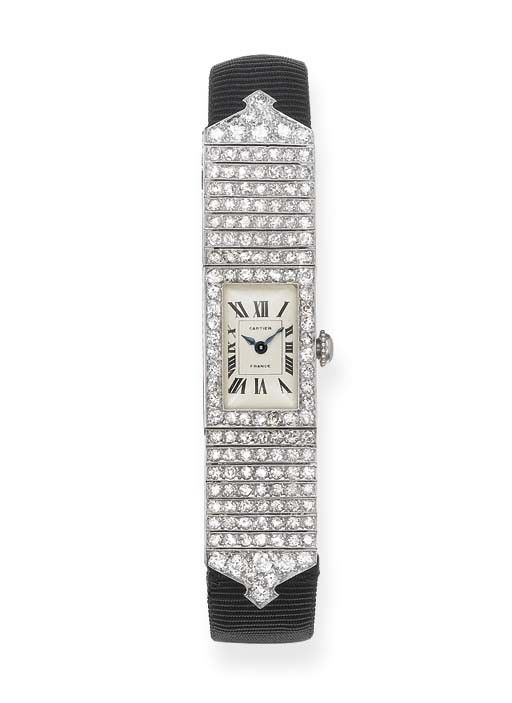 ART DECO DIAMOND WRISTWATCH, BY CARTIER   The rectangular cream dial with Roman numerals and blued steel hands to the diamond-set c1925