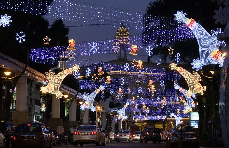 MALAYSIA | Motorists drive through the Christmas decorations on display for the upcoming Christmas celebration in Petaling Jaya, near Kuala Lumpur, Malaysia, Friday, December 11, 2009. (AP / Lai Seng Sin)