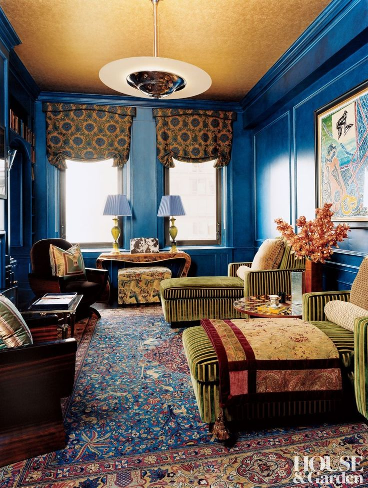 This Manhattan apartment designed by Matthew Smyth Inc. is the embodiment of how to use boldly painted trim to achieve cohesion. The glazed cobalt blue walls, wainscoting and crown perfectly offset the bright yellow ceiling and bold patterns in throughout the room. #trimwork #wainscotting #crownmoulding #inspiration #interiorfinishings #moulding