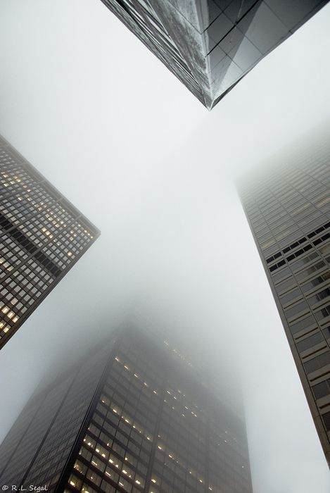 Brilliant Perspective of of the four Skyscrapers. Fog adds to the effect, not knowing where the buildings end.