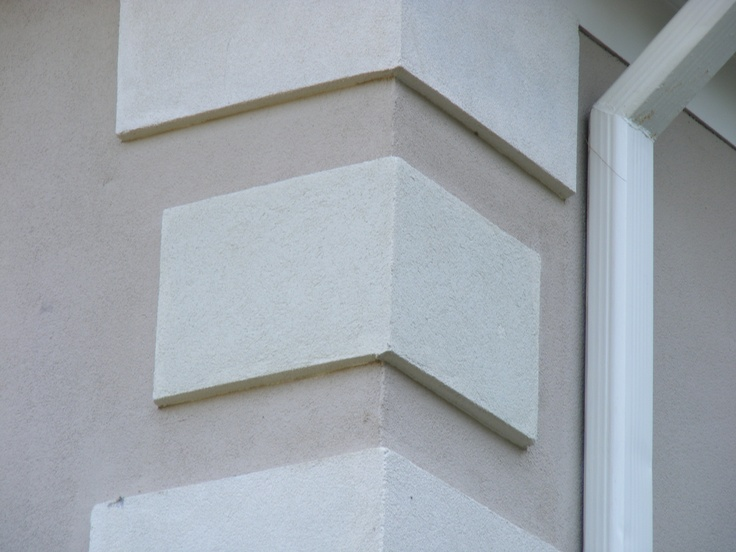 Quoins pronounced coins are often found on the corners for Concrete block stucco