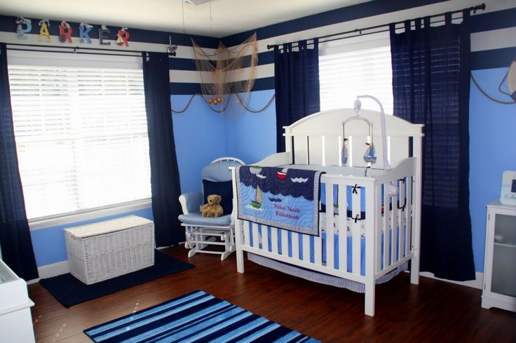 Baby Nursery Developing Modern Baby Nursery: Things to Consider: Cool Navy Blue Sea Little Sailor Baby Nursery Room Theme Design With Solid White Wood Furnished Baby Crib And Rattan Storage Box
