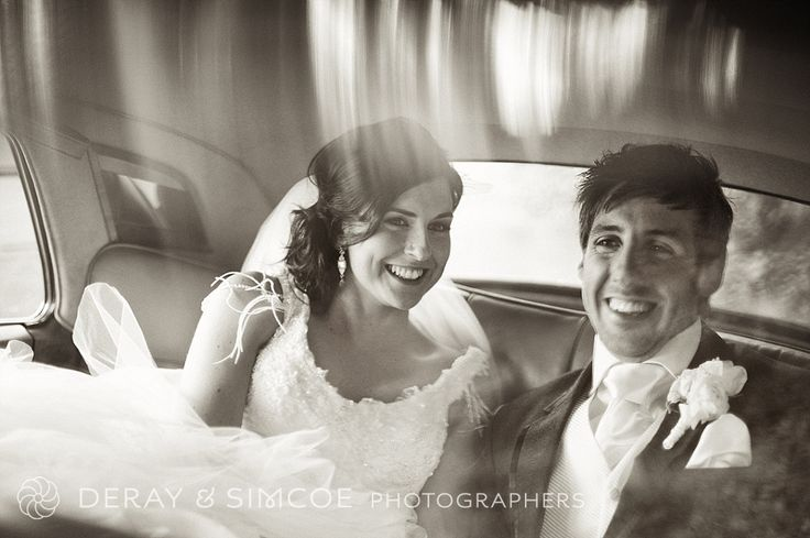 Just married. Wedding couple photos inside a vintage white wedding car