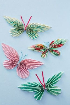Spring butterflies! DIY by cutting pretty paper, accordion folding them, and adding pipe cleaners (or better: ribbon). Hang individually, or make a garland of them!
