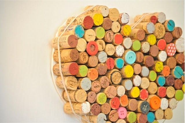 Cork craft heart - I love that she used buttons, paints and fabric.  But I REALLY love that she kept all these corks and even wrote dates and notes on them. Very cool.