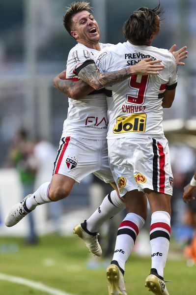Buffarini #18 and Chavez #9 of Sao Paulo celebrate a scored goal against Atletico MG during a match between Atletico MG and Sao Paulo as part of Brasileirao Series A 2016 at Independencia stadium on November 27, 2016 in Belo Horizonte, Brazil.