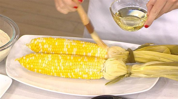 Grilled Corn w/Cornbread Butter ~ Blanch in boiling water 5 min.  Pull back light green husk, remove silks, pull back and tie with piece of outer husk.  (See Picture)  Brush corn w/evoo, salt, pepper - grill medium high heat until all sides lightly charrred.  Drizzle w/homemade butter and enjoy! The Today Show Memorial Day Recipe (Two Steps - blanch corn ahead then grill when ready)