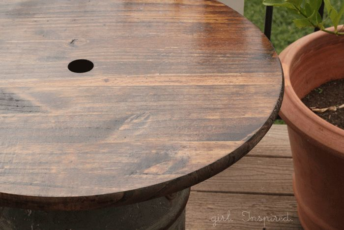 An outdoor side table made from an antique milk can!
