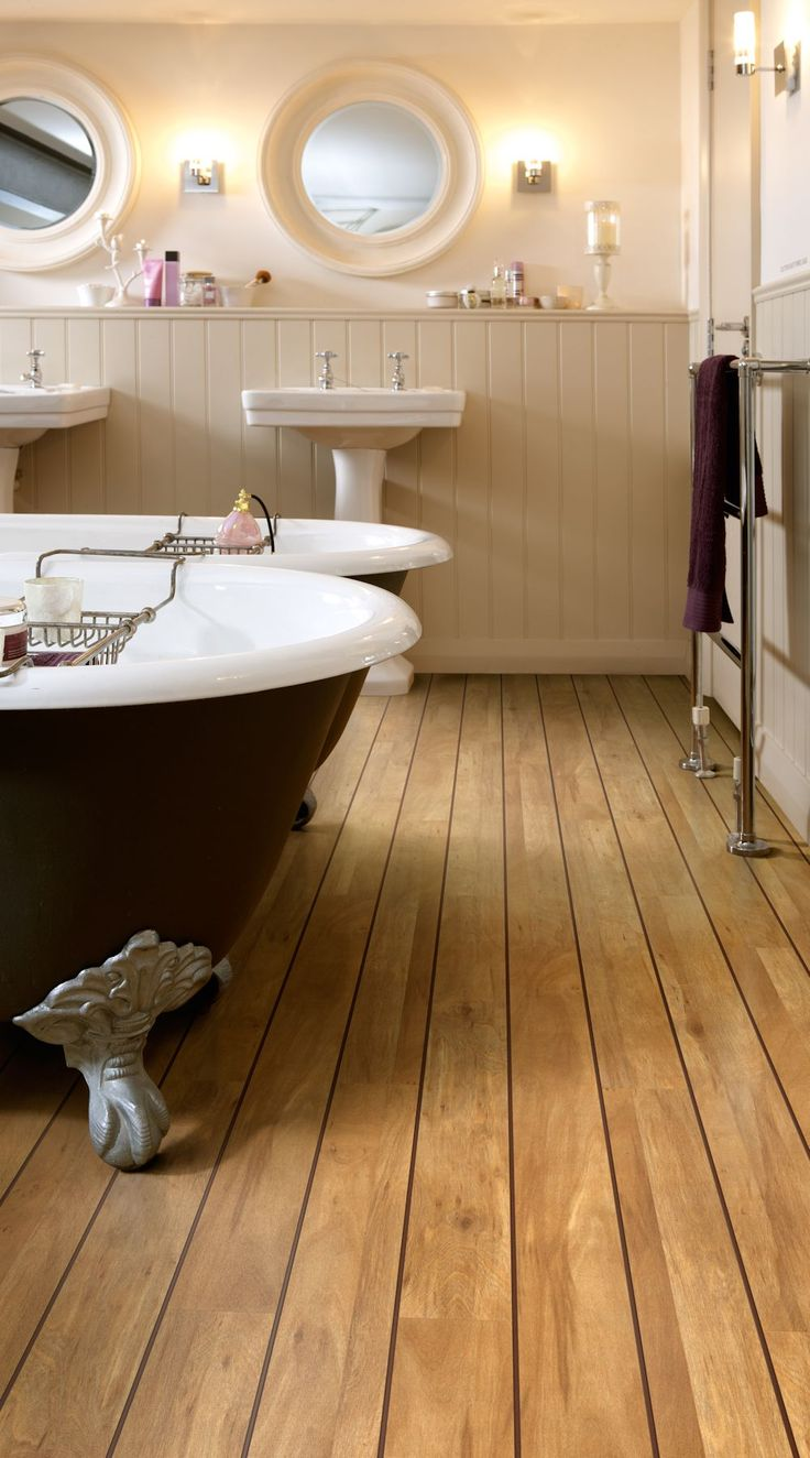 Wood Effect Colonia Golden Koa Luxury Vinyl Tile Flooring With Brown Feature Strip Creating Naval Plank