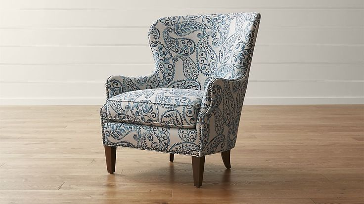 Shop Brielle Blue Wingback Armchair.   A textured linen blend gives the pattern a painterly quality, complemented by solid hardwood legs in a warm, pecan brown finish.  The Brielle Wing Chair is a Crate and Barrel exclusive.