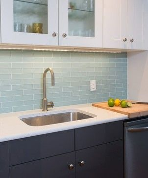 Backsplash: 1- by 6-inch brick glass tiles in Icelandic Blue, frosted, from the Signature Glass Collection by Akdo.