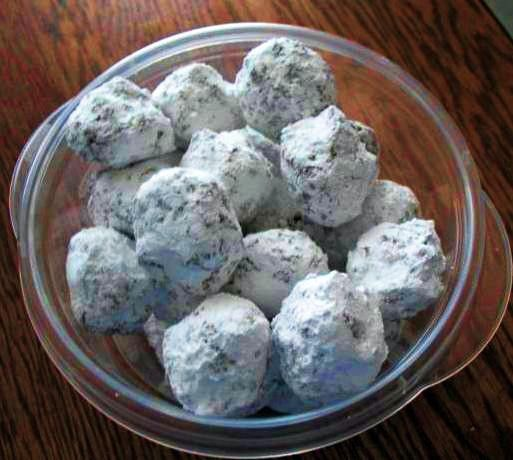 A recipe for Jim Beam Bourbon Balls made with box (12 oz size) vanilla wafers crushed, pecans, powdered sugar plus extra for coating