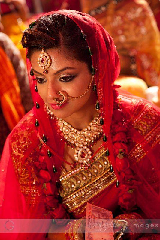 Much more red! Photo by Cory Goldberg Images, Goa #weddingnet #wedding #india #indian #indianwedding #weddingdresses #mehendi #ceremony #realwedding #lehenga #lehengacholi #choli #lehengawedding #lehengasaree #saree #bridalsaree #weddingsaree #indianweddingoutfits #outfits #backdrops #bridesmaids #prewedding #photoshoot #photoset #details #sweet #cute #gorgeous #fabulous #jewels #rings #tikka #earrings #sets #lehnga