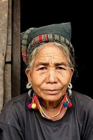 Laos | Portrait of an old woman of the Mouchi ethnic group wearing traditional clothes and jewellery . Village of Ban Mouchi Kang, Samphan District, Phongsali or Phongsaly Province | ©Imagebrokerrm by mari
