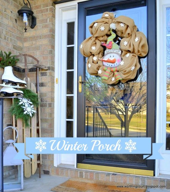 Winter porch with a snowman wreath, vintage sled and vintage ice skates via Worthing Court blog