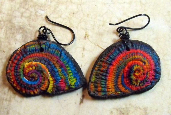 Colorful spiral/ammonite earrings made from polymer clay. Earhooks are non toxic black copper wire, theyll come with little stoppers.    whole