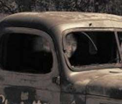A law enforcement officer took this picture of an abandoned old truck off of Honey Run Road in Chico, California.The optical illusion or ghostly apparition in the close up is quite striking.