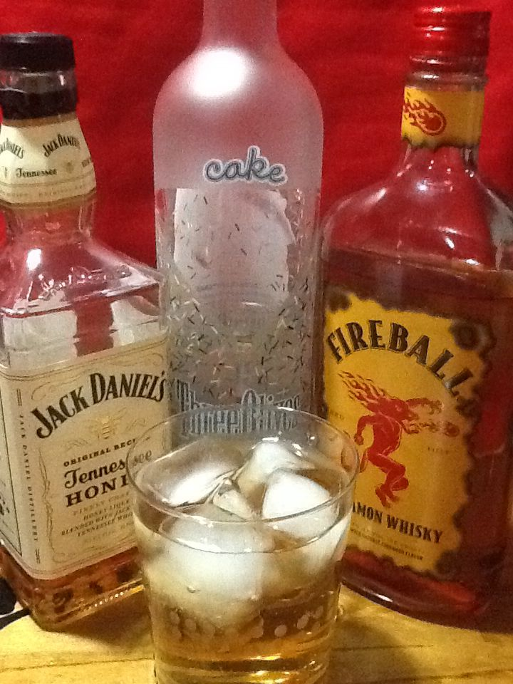 Fireball mixed drink - Lizard Balls 1 oz fireball, 1 oz Jack Daniels Honey, 1/2 oz cake vodka, ginger ale on the rocks
