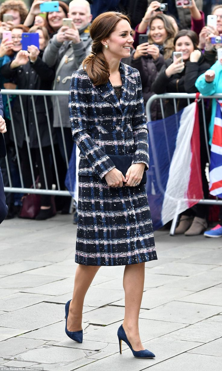 Kate looked chic in a navy and pink checked coat from Erdem's 2016 resort collection, whic...