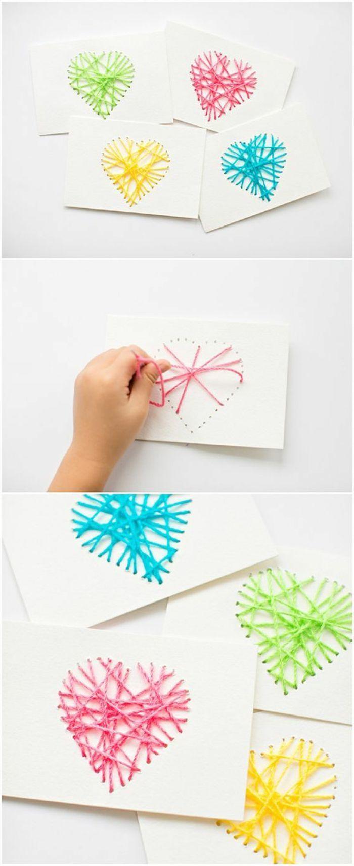 weißes papier, herzen aus buntem garn formen, diy wanddeko