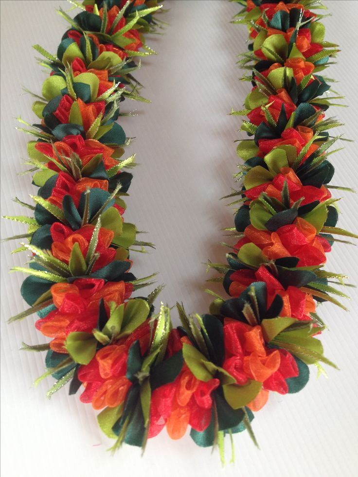 Surinam Pumpkin Cherry (Ribbon lei) designed by Tracy Harada Ui'mauamau