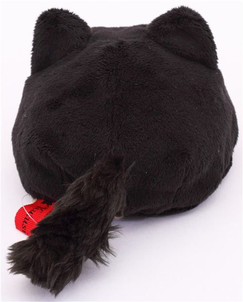 cat plushie by San-X from Japan with round cat laying on its belly