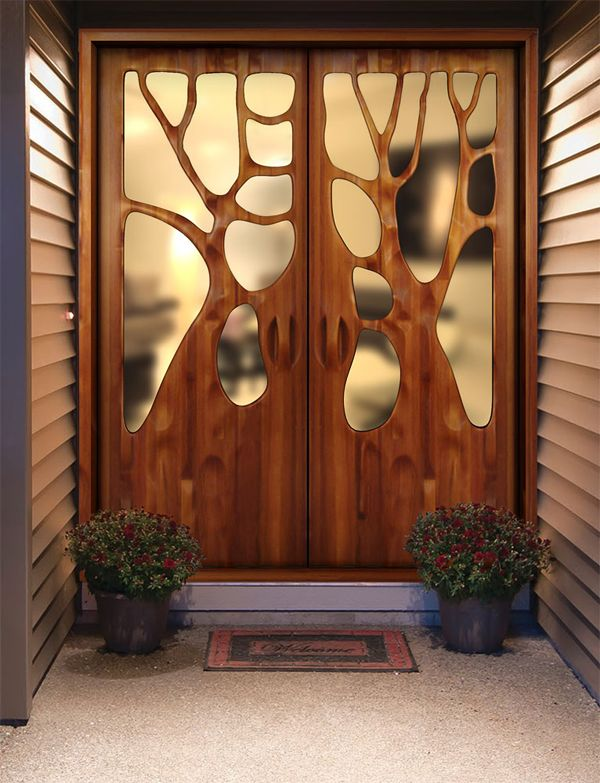"""I think this is a most beautiful front door.  From the site """"The two doors above are by artist and furniture designer Victor Klassen who we showcased a few weeks ago.  The way he shapes wood, bending and molding it like clay, is something only a master woodworker can do.  Klassen's designs show a deep reverence toward nature and his doors are among my favourite pieces. """""""
