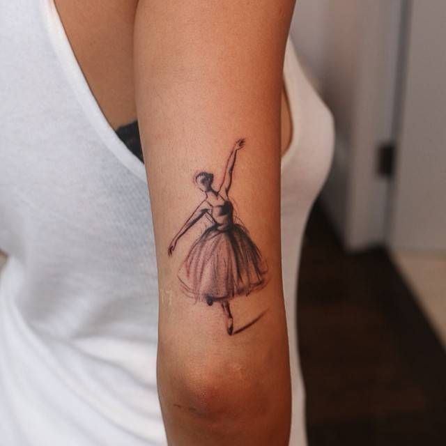 Rita Ora | Elegant ballet dancer inked on the outside of Rita Ora's right tricep, just above her elbow. Tattoo artist: Bang Bang · Keith McCurdy
