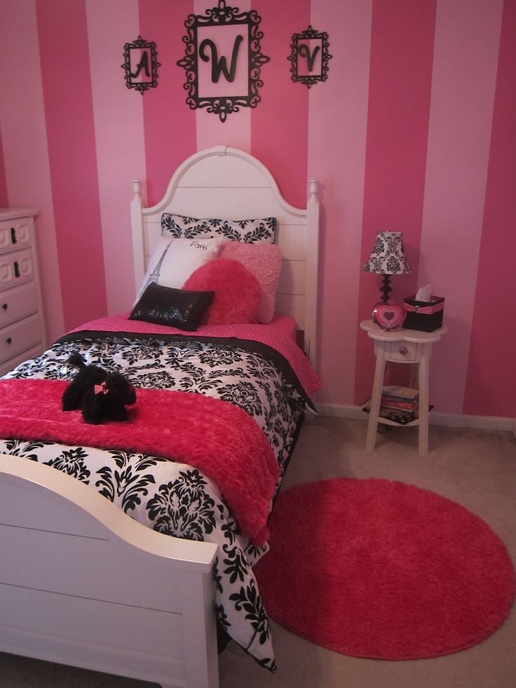 girls paris bedroom bed and rug love the stripes on the wall
